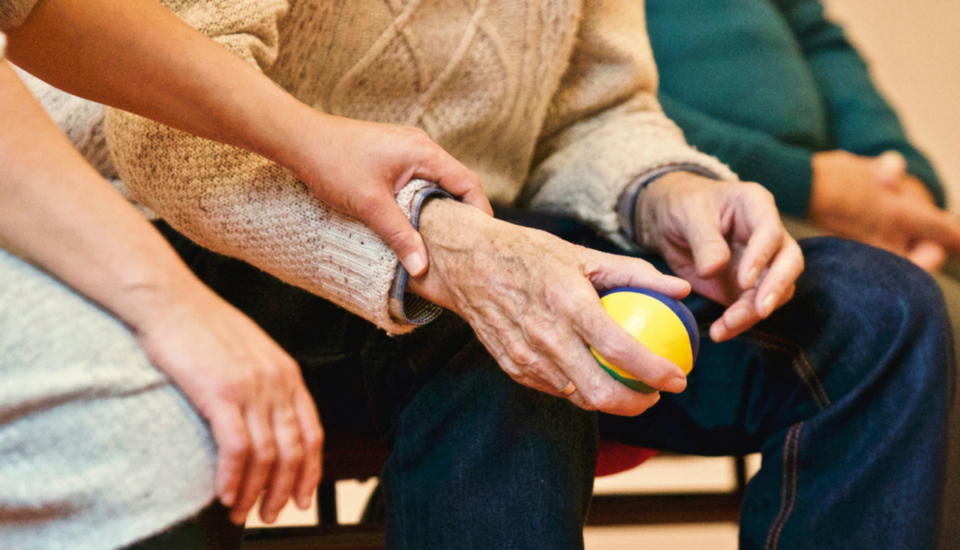 A picture of an elderly man and his daughter representing a senior citizen experiencing dementia or Alzheimer's disease who are considering holistic treatment options and functional medicine at Focus Integrative Healthcare