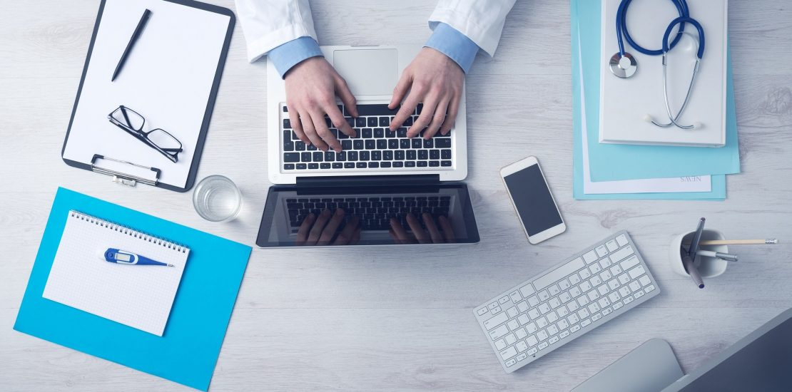 Photo of holistic, integrative, functional medicine, naturopath / naturopathic doctor preparing for online virtual telemedicine appointment